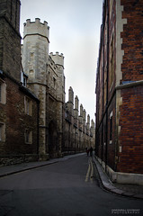 Old buildings line alleyway (dgoomany) Tags: england cambridge university universityofcambridge education higheducation smart intelligent colleges rivalry alleyway road buildings architecture old oldbuildings classical gothic stone stonework sculptures