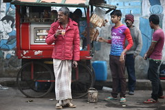 Drink Tea, Wear RED, Smile and Fly Emirates (N A Y E E M) Tags: tea stall customers morning colors graffiti red winter candid street norahmedroad chittagong bangladesh carwindow sooc raw unedited untouched unposed