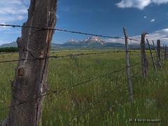 Utah Fence Line (jamesclinich) Tags: mountains sky clouds fences field landscapes availablelight handheld olympus omd em10 corel paintshoppro topaz denoise adjust clarity detail jamesclinich utah ut