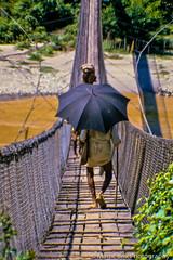 Rush Hour on the Bridge (Magic Brix) Tags: nepal diapo ombrello ponte concorso concorsi diapositiva slide candidata pokhara