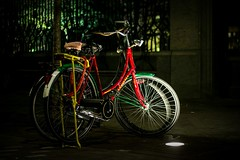 Inge Hoogendoorn (ingehoogendoorn) Tags: bike bikes bikeparking colorfull dark darkness light nightlight lights citylights streetphotography straatfotografie streetview floorlight floorlights night earlymorning rastacolors rastafari nightphotography city denhaag thehague bicycle bicycles duo two fiets fietsen