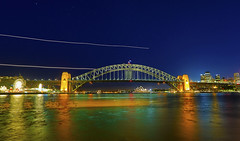 Sydney Harbour Bridge, Luna Park, Opera House : Starry night with two airplanes streaking by . . . (Clement Tang **bbbusy**) Tags: airplanelighttrack nightscene travel nsw newsouthwales sydneyharbour landscape seascape hdr sydneyharbourbridge sydneyoperahouse summer concordians scenicsnotjustlandscapes starrynight thecoathanger lunapark nationalgeographic