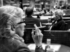street portrait people blackandwhite bw woman blur texture monochrome lensbaby table outside mono restaurant glasses holding sitting hand bend cigarette candid smoke streetphotography hairdo blowing smoking rings nails older bergen eyeglasses nailpolish badhabit coiffure selectivefocus passé manicured blowingsmoke windowglass naturalfilter selectivefocuslens acertainage bevelledglass dickensrestaurant silverefex sweet35 nikpreset speedystreetpreset