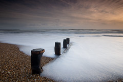 (Claire Hutton) Tags: wood uk longexposure sunset sea england white seascape beach nature water lens outdoors prime coast wooden sticks waves natural wave wideangle pebbles hampshire le foam poles groyne rolling ndfilter bartononsea leefilters ndgrads 5stop sonynex5r samyang12mmf20 5stopper
