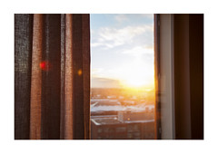 One fine morning (mkel) Tags: morning winter light sky sunlight snow window clouds sunrise finland helsinki view flare curtains hermanni kalasatama