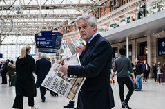 Standard geezer.... (jonron239) Tags: man newspaper waiting tie jacket standard glance concourse geezerwednesday