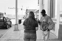 Excuse Me Miss (TnOlyShooter) Tags: film analog nashville tennessee streetphotography conversation olympusom1 kodaktrix400 olympusomzuiko50mmf18 findlab