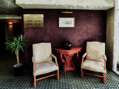 Rooms 101-108 (Steve Taylor (Photography)) Tags: shadow newzealand plant art texture wall architecture digital table carpet hotel chair picture pot nz vase southisland westcoast greymouth