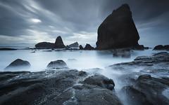premonition (chocoorange) Tags: blue cliff cloud beach rock indonesia long exposure wave eastjava papuma