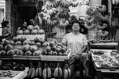 (milan syangbo) Tags: street portrait monochrome shop fruit night 35mm blackwhite eyecontact candid streetphotography streetlife banana portraiture fujifilm streetphoto blackdiamond streetshot candidshot shopkeeper xpro2