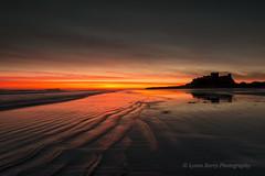 BAMBURGH BLAZE (lynneberry57) Tags: sea seascape water sunrise canon dawn coast colours northumberland ripples bamburghcastle 70d leefilters