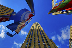 Flapping flags at Rockefeller Plaza . . . (Clement Tang **catching up**) Tags: newyorkcity travel autumn usa newyork architecture america landscape cityscape manhattan bluesky skyscaper 30rock nationalgeographic rockefellerplaza whiteclouds gebuilding rcabuilding 30rockefellerplaza comcastbuilding handheldhdr concordians scenicsnotjustlandscapes flappingflags