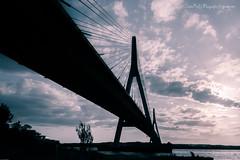 El pescador (Julin Ro Di) Tags: bridge clouds puente nubes cielos ayamonte 1650ssm sonyilca77