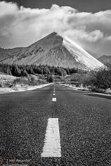 Glamaig (NeilAlexanderD) Tags: road longexposure cloud mountain snow weather sunrise dawn highway rocks isleofskye cloudy snowy noone nobody nopeople highland snowfall mountainpass mountainrange mountainpeak