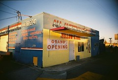 Yellow store (jfpj) Tags: auto california blue film sign yellow store toycamera handpainted storefront signage vivitar plasticcamera redwoodcity trashcam fairoaks 10faves vivitarultrawideandslim