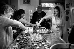(heatherbirdtx) Tags: wedding blackandwhite kitchen cake houseparty dessert bride veil availablelight candid interior group cream help gown jars whipped