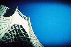 Tehran (cranjam) Tags: tower film monument architecture lomo lca xpro lomography gate torre iran kodak monumento middleeast slide persia porta marble tehran architettura islamicarchitecture marmo elitechrome100 mediooriente freedomsquare azaditower islamicrevolution azadisquare hosseinamanat  borjeazadi