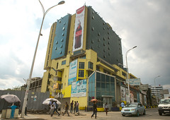 Giant billboard of coca cola on side of a mall, Addis abeba region, Addis ababa, Ethiopia (Eric Lafforgue) Tags: africa street city color building sign shop horizontal retail facade mall shopping giant poster outdoors store commerce exterior capital large billboard advertisement business commercial shoppingmall huge ethiopia addisababa signboard development consumerism enormous hornofafrica advertise eastafrica thiopien etiopia abyssinia urbanscene ethiopie etiopa buildingexterior fulllenght addisabeba dembel  etiopija ethiopi  ethnicgroup etiopien etipia  etiyopya  goupofpeople         addisabebaregion ethio163096