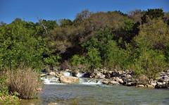 The Rushing Waters of Barton Creek (thor_mark ) Tags: trees nature creek austin stream unitedstates tx blueskies hillside bartoncreek bartoncreekgreenbelt smallwaterfall project365 colorefexpro lookingnw nikond800e capturenx2edited hillsideoftrees sayinggoodbyetosunshine