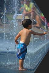 Reaching Around The Corner (Scott 97006) Tags: park boy wet water fountain kid time reaching space physics reach phenomenon