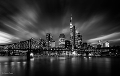 Frankfurt Skyline (cfaobam) Tags: bridge light bw white black water skyline architecture night skyscraper canon river germany deutschland lights evening wasser europe long exposure european cityscape hessen slow skyscrapers cloudy nacht frankfurt tripod central bank hour stadt highrise architektur sw schwarz banks frankfurtammain commerzbank deutsche hesse mainhattan weis zentralbank europische bankfurt cfaobam