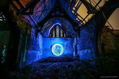 Eldritch Scenes From A Dead Church (john&mairi) Tags: orb lightpainting stcolumbas episcopal church glasgowroad dumbartonroad clydebank glasgow derelict abandoned ruined roof truss beams sodium lampglow sky starofdavid window altar eldritch grafitti christianity judaism light pollution rubble pillar