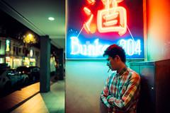 Lone Wolf (Jon Siegel) Tags: nikon d810 sigma 24mm 14 sigma24mmf14art sigma24mm 24mmf14 sigmaartlens man lone smoking smoke cigarette neon light ambience glow street night club nightclub asia chinese singapore singaporean people modeling model wongkarwai cinematography cinematic