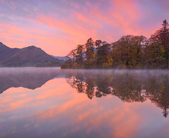 Daybreak (Aubrey Stoll) Tags: travel trees england sky cloud mist holiday mountains tourism water clouds sunrise reflections northwest britain derwent lakedistrict dramatic cumbria fells destination leisure skyclouds leaveshills