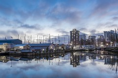Vancouver Bay \ Coal Harbor Reflection (ChristianChance) Tags: ocean canada reflection water vancouver sunrise boats mirror bay harbor boat dock nikon bluesky d750 blueskies 1635 1635mm watermirror vancouvercanada vancouverbay thepinnaclehof nikond750 tphoffebruary2015