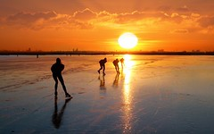 Skating away on thin ice into the sundown (Bn) Tags: winter sunset sun lake cold holland ice netherlands dutch speed reflections de geese meer die glow tour sundown natural bevroren outdoor skating over n nederland cities silhouettes skaters gans topf300 freeze skate forever op wintertime topf100 iconic 500faves eleven epic topf200 januari iceskate waterland schaatsen the schaats greylag holysloot topf400 ijspret elfstedentocht topf500 ransdorp grauwe 100faves 200faves natuurijs gekte 300faves 400faves world100f ijstochten holysloter ganzentijd