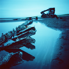 Bones and blue (Zeb Andrews) Tags: longexposure blue 6x6 oregon mediumformat square landscape uv 120film hasselblad pacificocean shipwreck astoria pacificnorthwest oregoncoast westcoast analogphotography fortstevens peteriredale filmphotography ndfilter colorfilm filmisnotdead hasselblad500c kodakektar100