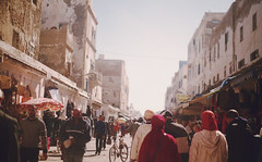 (Joelle Poulos) Tags: city travel urban house film photography minolta market candid morocco walls bustling