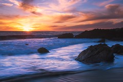 pacific (Andy Kennelly) Tags: california light motion wet clouds sand rocks colorful waves pacific malibu pch