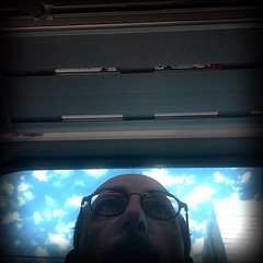 On the Train (lesliegill) Tags: blue sky people selfportrait japan clouds train tokyo iphone