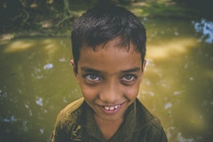 Stormy Eyes! (T A S F I Q) Tags: portrait people brown smile june kid pond eyes teeth wideangle research ramadan cyclone 2016 fulloflife roanu barisal banglaesh borguna d7000 iamnikon gibika tasfiqmahmood