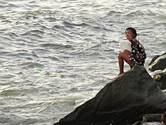salute to the photographer (DOLCEVITALUX) Tags: sea water girl rocks image finger philippines photojournalism streetchildren