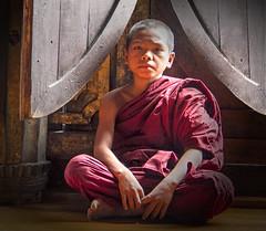 Baby monk (bag_lady) Tags: sitting burma buddhist religion monk buddhism monastery myanmar inlelake spiritual burmese shanstate youngmonk shweyaunghwekyaung ordinationhall teakmonastery
