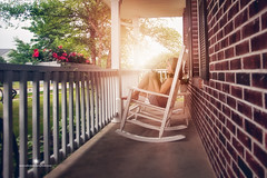 (Rebecca812) Tags: flowers trees summer portrait sunlight house brick home girl childhood canon spring day technology child tech candid wideangle porch wireless rest rockingchair relaxation frontporch tablet stolenmoments otudoors rebecca812