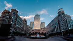 Cabot Square (Mayur Shivz - Out and about casual photography) Tags: fountain cabot square canary wharf united kingdom fuji velvia 50 film emulation olympus omd em5 samyang 75mm fish eye credit suisse morgan stanley place dockland central one canada hsbc citi