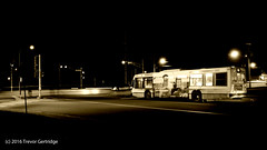 In transit (Trevdog67) Tags: street intersection bw bn blackandwhite blancetnoir bus public transit codiactranspo moncton newbrunswick nouveaubrunswick canada 2016 westmorlandcounty nikon d7100 nikkor 18300mm night soir