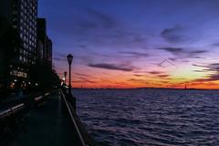 Along the Battery Park Esplanade (ho_hokus) Tags: sunset newyork unitedstates manhattan batterypark esplanade hudsonriver statueofliberty batteryparkcity iphone 2013