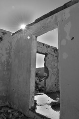 Starburst (Cesar Solis CESO) Tags: door old bw house abandoned window neglect decay perspective ruin sunburst starburst