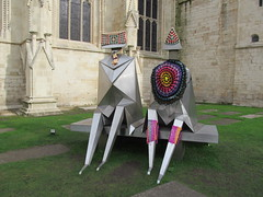 Yarn bombed! (pefkosmad) Tags: street city urban sculpture art wool public knitting funny exterior cathedral crochet exhibition gloucestershire yarn gloucestercathedral lynnchadwick guerillaknitting crucible2 yarnbombing sittingcoupleonabench naughtyknitter