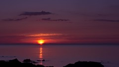 Sunset Over The Black Isle (Tidyshow) Tags: sunset red sea mountains water scotland rocks purple tide highland