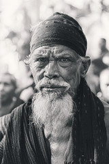 Lewotolok Elder, Lembata (syukaery) Tags: old trip travel portrait people blackandwhite bw man tourism senior monochrome indonesia beard mono nikon village traditional culture monochromatic portraiture elder cloth nikkor tribe humaninterest garb lembata 24120mm whitehaired d700 eastnusatenggara vsco