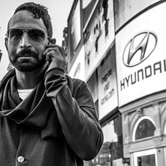 Metrosexual (Street matt) Tags: street bw man money london sunglasses fashion advertising beard photography cool candid piccadillycircus squareformat creativecommons mobilephone hyundai brand metrosexual candidportrait