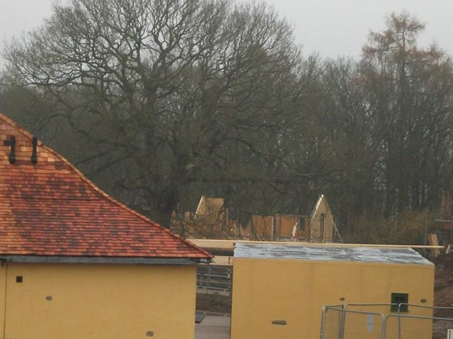 29/11/14 - A closer look at one of the lodges without its roof installed.