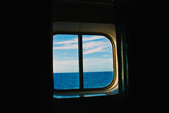 Peering Out into the Sea (aitramah) Tags: ocean travel cruise blue sea seascape window nature water landscape photography boat scenery contemporary oceanscape