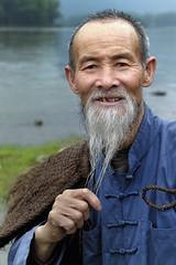 Cormorant Fisherman - China (Joao Eduardo Figueiredo) Tags: fish bird water river liriver li fishing fisherman asia village fishermen guilin yangshuo cormorant raft guangxi xingping cormorantfisherman joaofigueiredo nikond800e joaoeduardofigueiredo