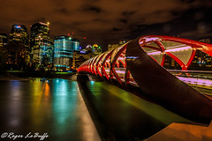 The Red Carpet into Calgary (snypper@rogers.com) Tags: city longexposure bridge santiago red sky canada calgary water beautiful architecture modern night clouds river lights cyclists cityscape peace crossing peaceful pedestrian calm alberta citylights calatrava serene modernarchitecture tranquil bowriver santiagocalatrava rivercrossing pedestrianbridge 30secondexposure composed landsacpe redbridge peacebridge downtowncalgary calgaryatnight serenesetting bridgearchitecture longexposurenight cans2s calgarycityscape serenebridge march24th2012 designedbyspanisharchitectsantiagocalatrava nightimecalgary redpeacebridge crossingthebowriverincalgary shawcalgary openingdaymarch24th2012